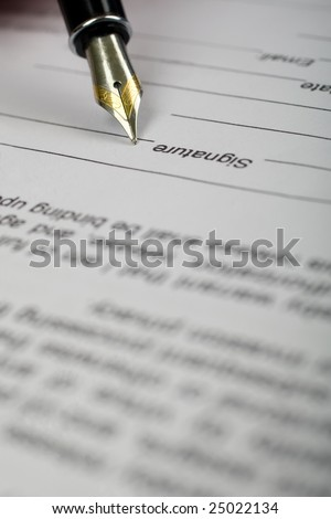 Closeup of pen with plume signing signature in document bottom - stock photo