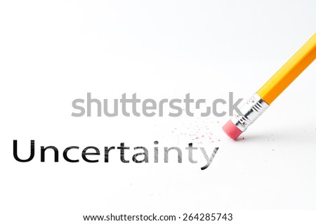 Closeup of pencil eraser and black Uncertainty text. Uncertainty. Pencil with eraser. - stock photo