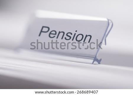 Closeup of Pension tab on white table - stock photo