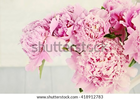 Closeup of peony flowers in a vase. - stock photo