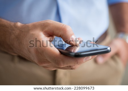 Closeup Of Person's Hand Holding Touchscreen Smartphone - stock photo