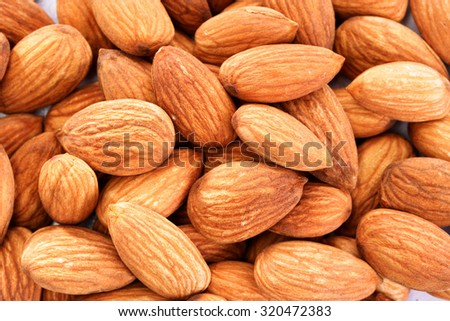 Closeup of Pile of almonds for background.  - stock photo