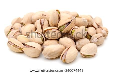 closeup of pistachio nuts on white background  - stock photo