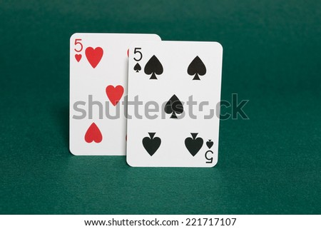 Closeup of pocket fives starting hand in hold'em poker also called the speed limit in horizontal view - stock photo