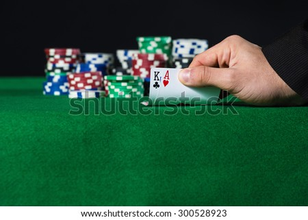 Closeup of poker player with two aces