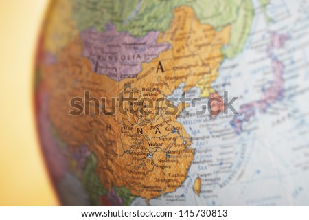 Closeup of political globe showing China - stock photo