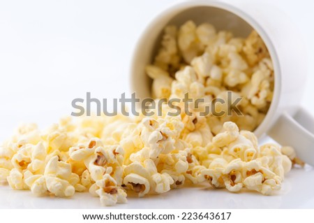 Closeup of popcorn in the cup on white background - stock photo