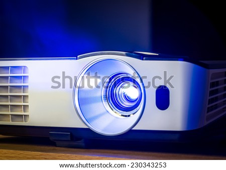 Closeup of projector for presentation in blue light tone - stock photo