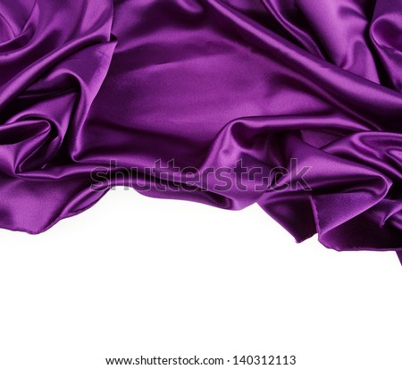 Closeup of purple silk fabric on white background - stock photo