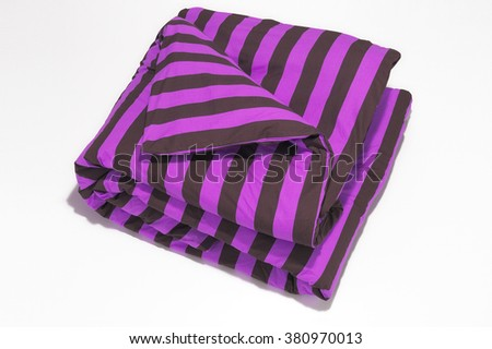 Closeup of purple striped comforter on white background - stock photo