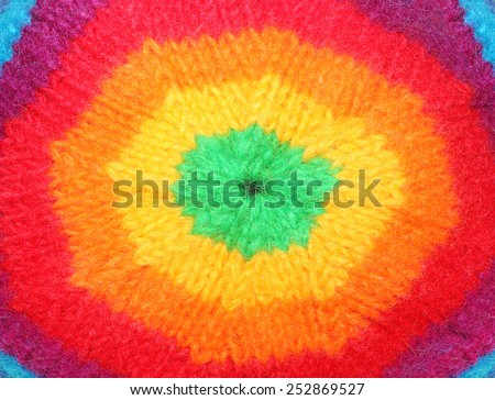 Closeup of rainbow rasta cap. Homemade knitted product. Fashion background. - stock photo