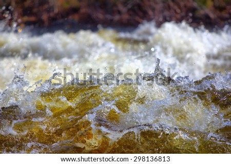 closeup of  rapid waters of  river strong - stock photo