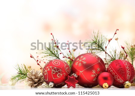Closeup of red Christmas balls and fir branch on white  background. - stock photo