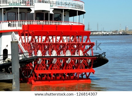 Closeup Of Red Paddle Wheel On River Boat - stock photo