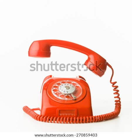 closeup of red vintage phone ringing, isolated on white background - stock photo