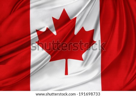 Closeup of rippled Canadian flag  - stock photo