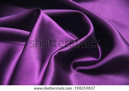 Closeup of rippled purple silk fabric - stock photo