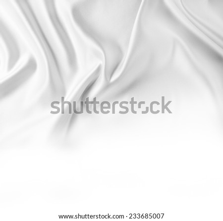 Closeup of rippled silk fabric on white background - stock photo
