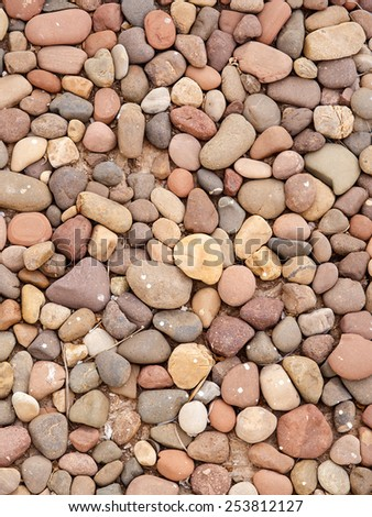 Closeup of river pebbles for use as background or texture - stock photo