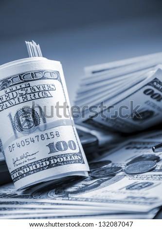 Closeup of roll up American bills - stock photo