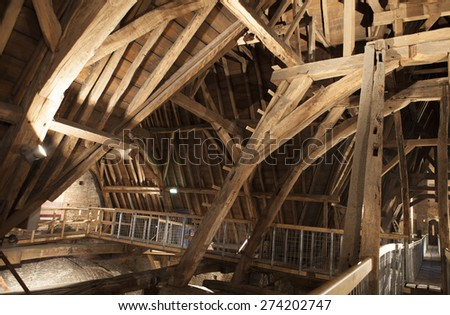 Closeup of roof beams on church ceiling - stock photo