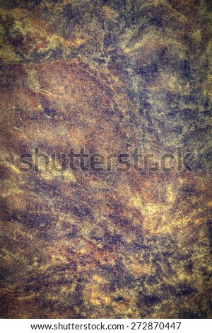 Closeup of rough stony texture with vignette effect as background - stock photo