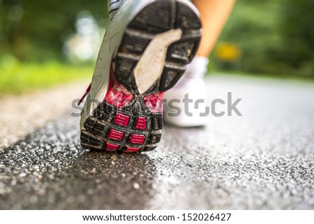 Closeup of runner feet running. - stock photo