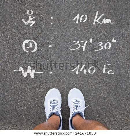 Closeup Of Runner's Feet With training data and infos about his training - stock photo