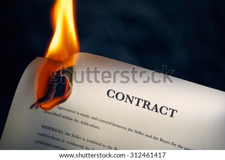 Closeup of sale agreement burning. Concept shot of freedom and new beginnings.  - stock photo