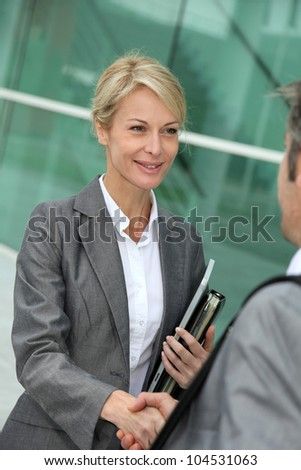 Closeup of sales woman shaking hand to business patner - stock photo