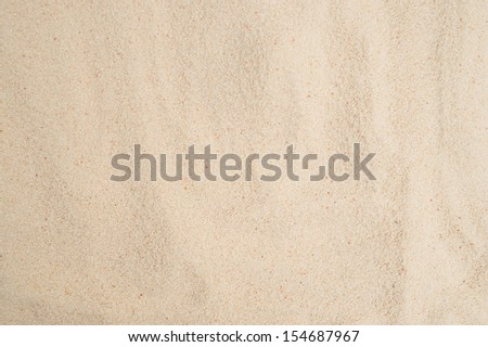 closeup of sand texture of a beach. - stock photo