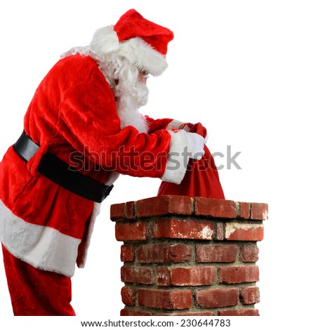 Closeup of Santa Claus placing his bag of toys into a chimney. Vertical format over a white background. - stock photo