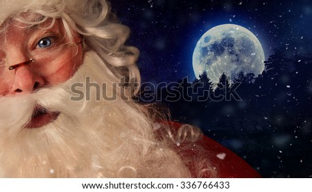 Closeup of Santa Claus with night sky and moon in background - stock photo