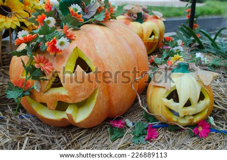 closeup of scary halloween pumpkins - stock photo