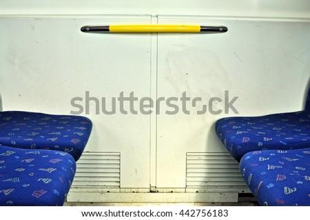 Closeup of seats on public transportation train. - stock photo