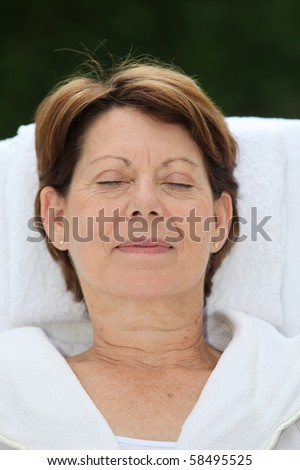 Closeup of senior woman relaxing on massage bed - stock photo