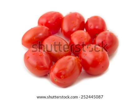 Closeup of several ripe plum tomatoes (also known as a processing tomatoes or paste tomatoes), isolated on white background - stock photo