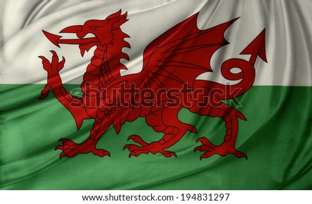 Closeup of silky Welsh flag - stock photo