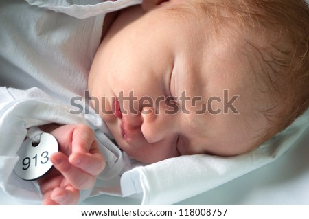 Closeup of Sleeping Newborn Baby in Maternity Hospital - stock photo