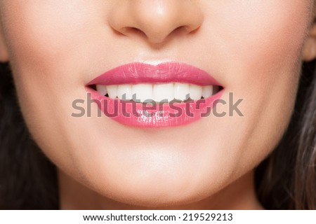 Closeup of smile with white beautiful healthy teeth - stock photo
