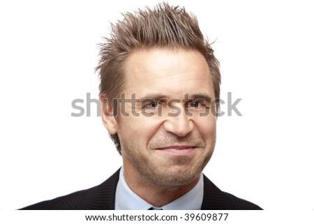 Closeup of smiling businessman on white background - stock photo