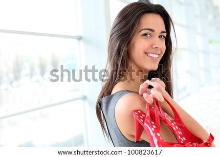 Closeup of smiling businesswoman holding red hills - stock photo