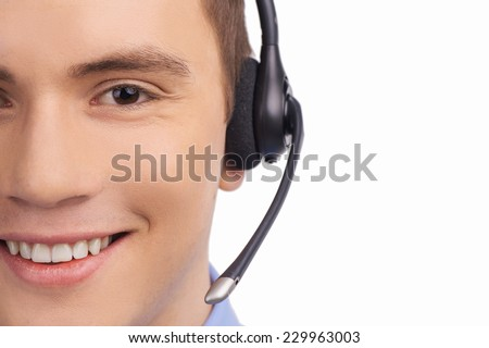 Closeup of smiling customer service agent with headset. Call center male operator isolated on white  - stock photo