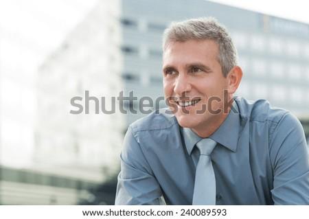 Closeup Of Smiling Mature Businessman Outdoor - stock photo