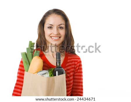 closeup of  smiling woman with full grocery bag - stock photo