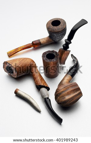 Closeup of smoking pipes isolated on white background - stock photo