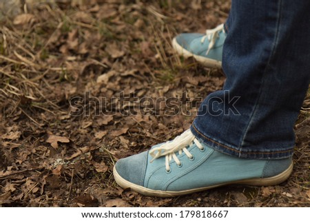 Closeup of sneakers on the leaves - stock photo