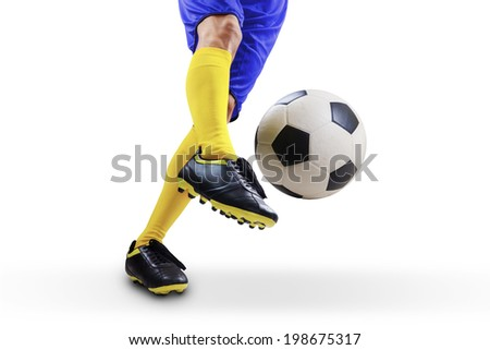 Closeup of soccer player foot kicking the ball. Isolated on white background - stock photo