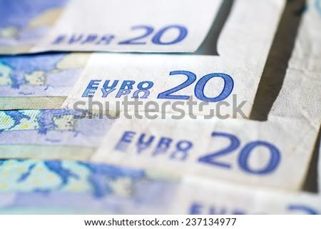 closeup of some banknotes of twenty euro - stock photo