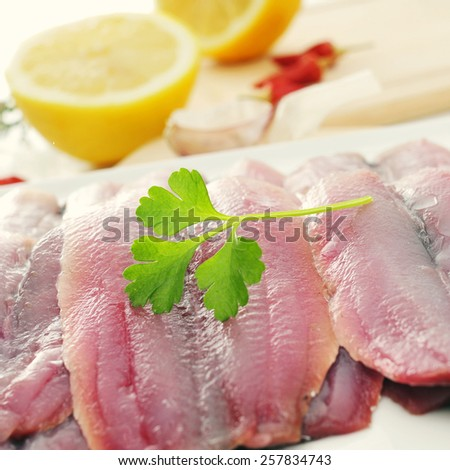 closeup of some filleted raw sardines in a plate - stock photo